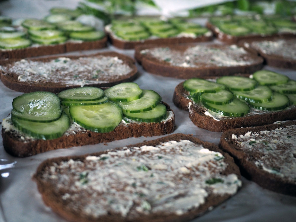 I placed 3 slices in a row x3. This way when I cut the bread into finger sandwiches I used the cucumber rows as my guide to create 3 bite sized sandwiches.