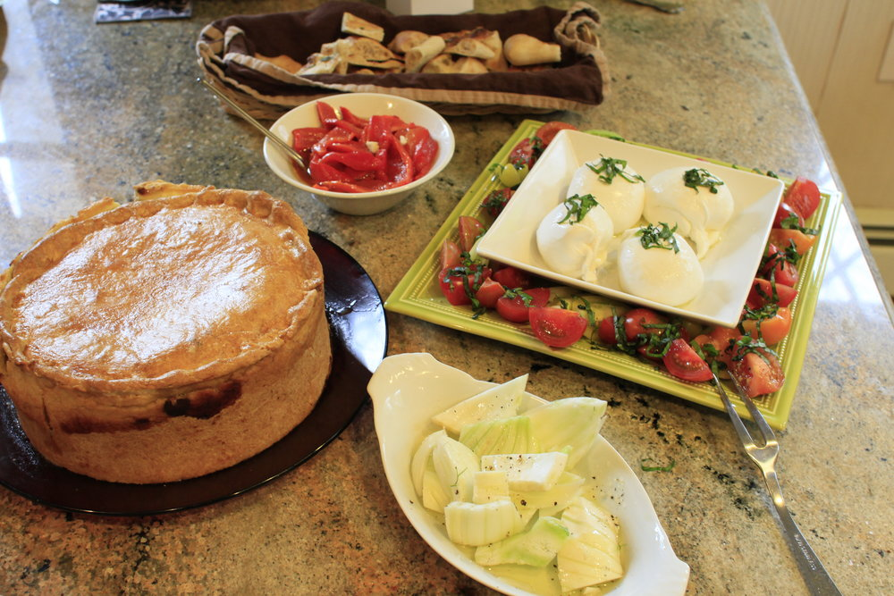 Some traditional Italian Easter appetizers.   Pizza Rustica   , fresh tomatoes and burrata, crisp fennel/olive oil.