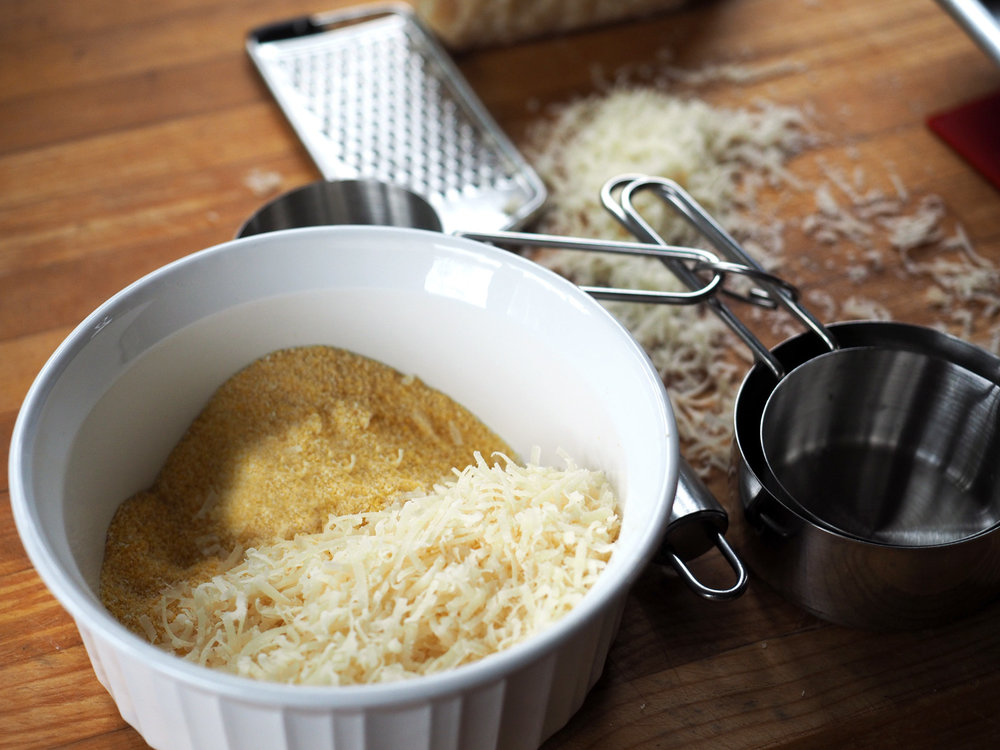 Combine the polenta and cheese together.