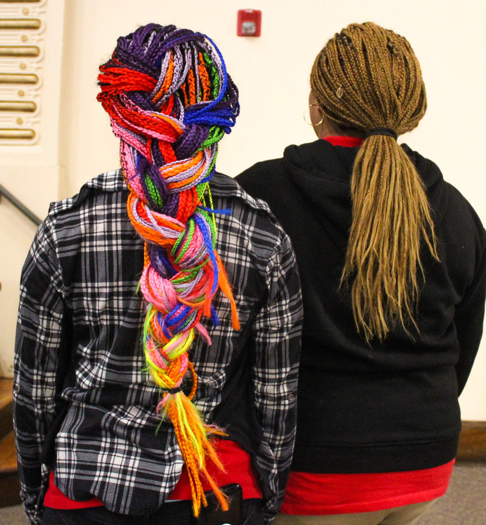Dalayja Dickson and Destiny Montez adds charms and colors to their hair as ways to express who they are within a strict dress-code policy.