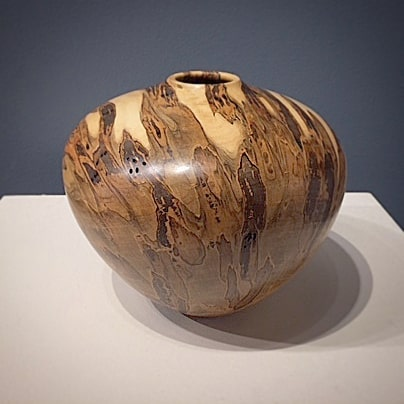 """New ambrosia maple hollow form. See what's on display at Ariel Gallery (@ariel.gallery.avl) in downtown Asheville.  7"""" high by 7"""" wide  www.stevenoggle.com  #woodturning #woodwork #woodstudio #turnedwood #woodworking #wooddecor #homedecor #artgallery #asheville #arielgallery #nc #ncartist #ncart #followart #woodart #ambrosia #maple #hollowform #vessel #wood"""