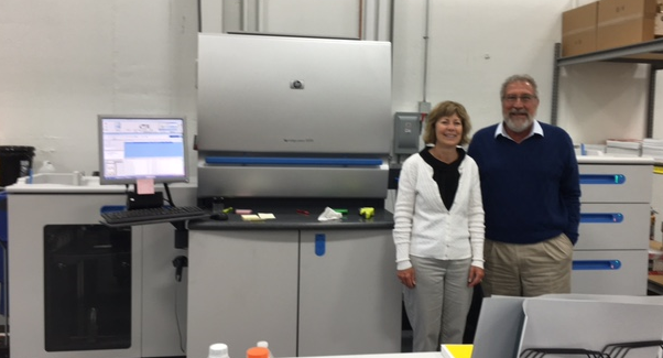 Standing next to the printing press that will print our gala invitations is Executive Director, Linda Wiza, and   Tenenz, Inc.   owner, Bob Tenner.