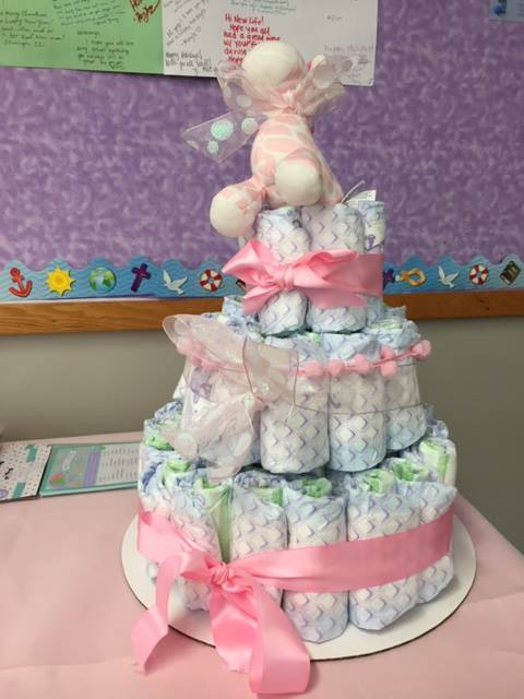"""Diaper"" cake.  More photos    One mom wrote, ""I would like to take a moment to thank all the staff and organizing committee, and all who participated in our baby shower. May our good Lord richly bless you all. Again, thanks!"""