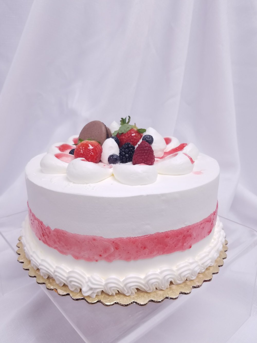 Traditional Strawberry Shortcake A crowd favorite. Beautifully soft lemon sponge cake layered with our famous Strawberry Mascarpone cream and fresh strawberries for a deliciously light dessert that will have everyone wanting seconds.