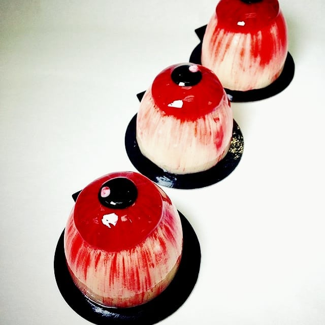 """Lavande is celebrating Halloween early! Our blood shot eye balls! Made with GF Pistachio Cake, Sour Cherry """"blood filling and white chocolate mousse. It's creeptastic! Available for the weekend until it's sold out!"""
