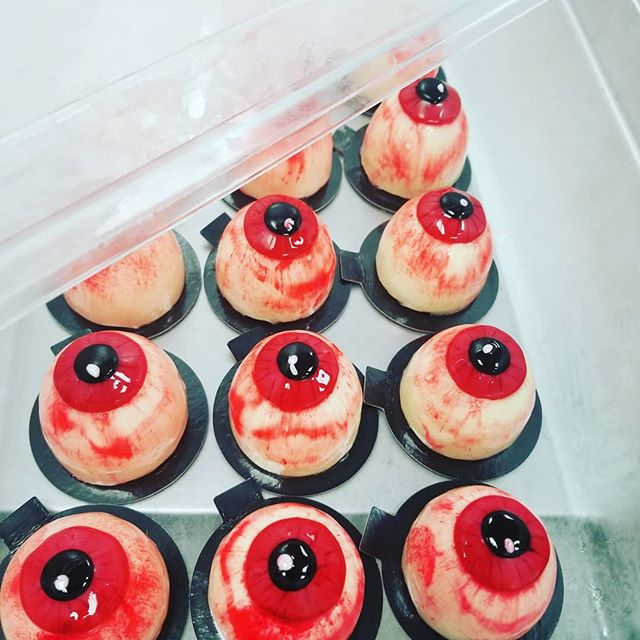 """Grab em while they are still some left! Our Halloween bloody eye. With GF Pistachio Cake, Liquid Cherry """"Blood"""" and White Chocolate Mousse. It's creeptastic! #lavandepatisserie #patisserie #pastrychef #cafe #coffeeshop"""