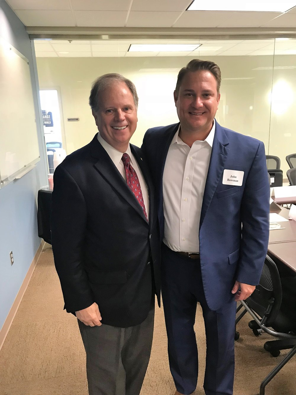 CEO John Bowman (right) meets with U.S. Senator Doug Jones (left)