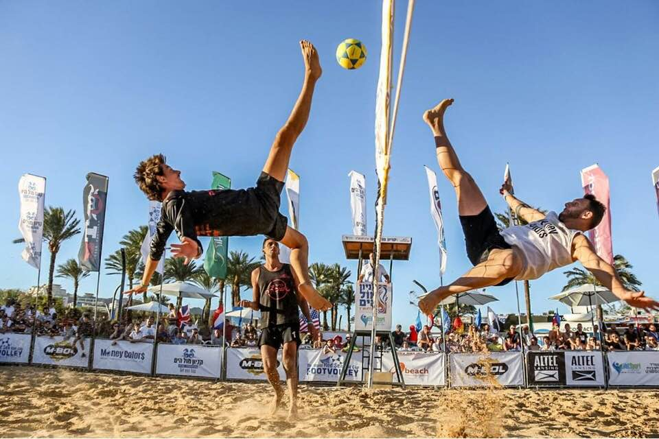 Portuguese and European champion Miguel Pinheiro with a shark block on Brazilian super star Eduardo Gasparini. The crowd witnessed a very high level in the final. Photo: Eilat Footvolley