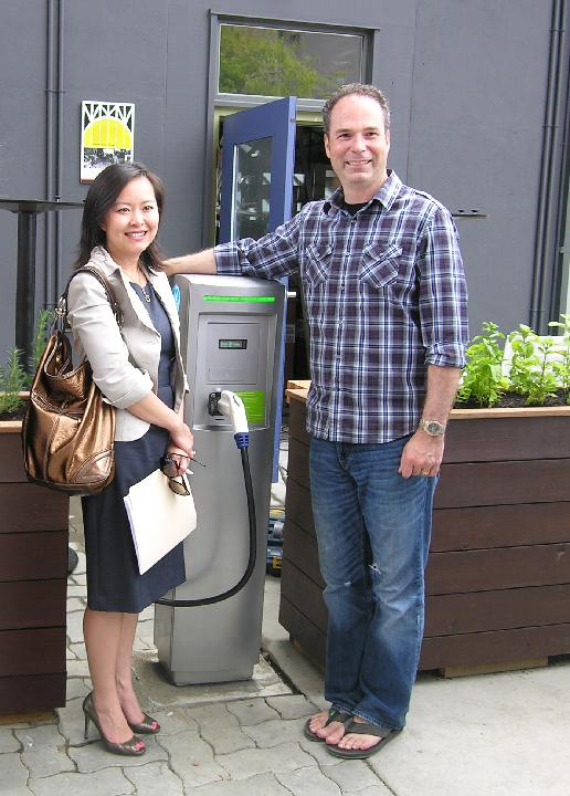 Kathy Nguyen, Acting President & CEO at Powertech, and Eric Patemen, President & Founder of Edible Canada launch the first EVSE install on Granville Island