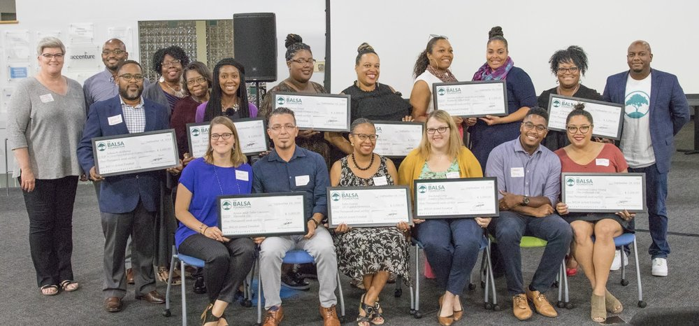 The BALSA Foundation Summer 2018 BALSA Grant awards. Each first-time entrepreneurs will receive $1,000 in cash grants, along with professional services and mentorship to help them start and grow their business. (Sitting Left to right: Anna and Tello Carreon, Elevada LLC; Kita Quinn, 1K Digital Memories; Rachael Cross, Simply Chic Jewelry; Charlene Lopez and Darren Young, The Fattened Caf; Standing Left to right: Colleen Mulvihill, SLEDP; Aziz Traore, BALSA Foundation; Julius B. Anthony, St. Louis Black Authors of Children's Literature; Monica Turner, Angela Byrd and DeAnna Tipton, Byrds of Expression; Whitney Jones, Transitional Homes 4 You; Shelby Farr, Luxury Body Bar; Serrita Sydnor and Alicia Cooper, Butterfly Effect G2W; Charlene Williams, C.H.A.R.M.'D; Michael Bynum, BALSA Foundation).