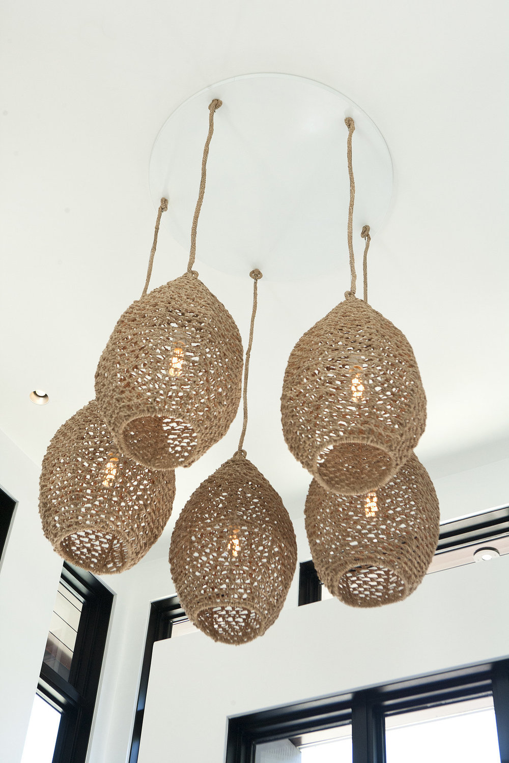 foyer-pendant-lights-woven-from-natural-material-resemble.jpg