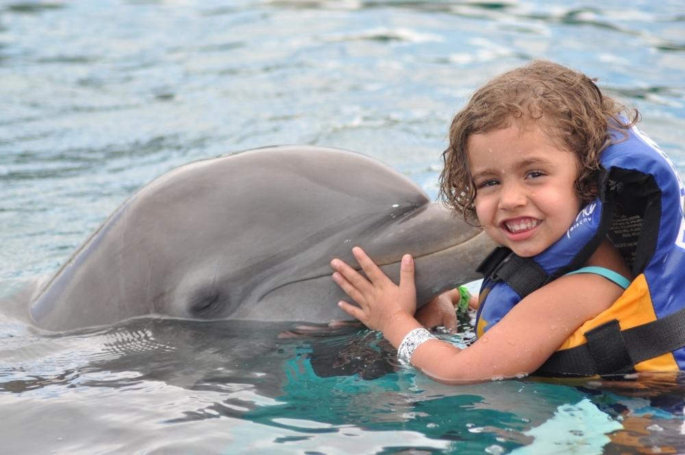 Dolphin Encounter Kiss little girl.jpg