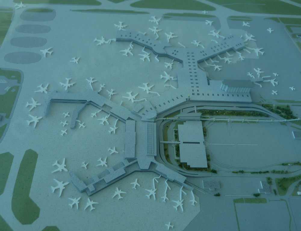 Click on this charming scale model to open up maps of the airport, hosted at the YVR website