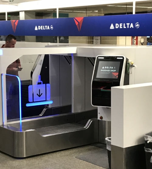 Delta has installed automatic luggage drop centers at the main terminal check-in. these have the potential to significantly speed up the process, especially for traveling families!