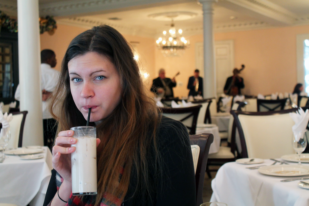 "Excuse my face here. I was very much enjoying my brandy milk punch but I was also incredibly tired! Weekend trips are exhausting! Also how cute is the ""courtyard jazz band"" playing behind me?! This is at Broussard's if you want to enjoy some music with your brunch."