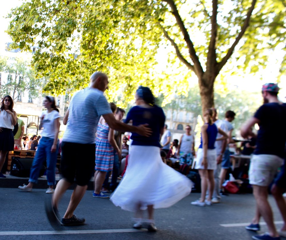 dancing on the Seine embankment