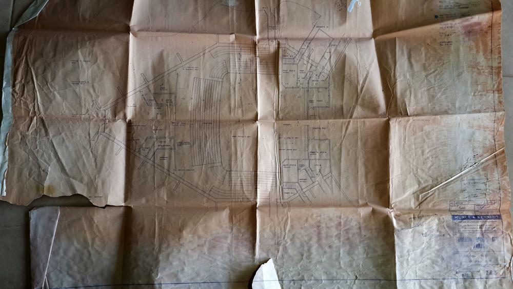 A Photograph of an original floor plan of the Culture Palace in al-Hussein Youth City. .الصورة لمخطط أصلي لقصر الثقافة في مدينة الحسين للشباب