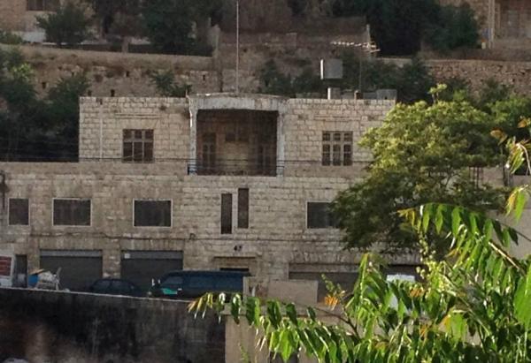 General view of the Khalaf Tell house.   لقطة عامة لمنزل خلف التل