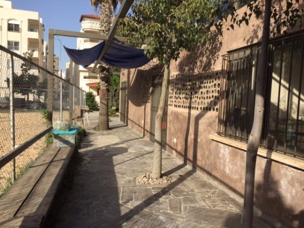 View of the multi-use building built by Nour al-Barakah organization using recycled materials   لقطة للمبنى متعدد الإستعمالات الذي قامت جمعية نور البركة ببنائه باستخدام مواد معاد تدويرها