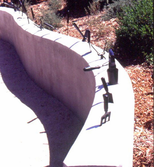 Figure 10: The Water Conservation Demonstration Garden in San Diego, California: Gardening tools fixed on top of a low wall.