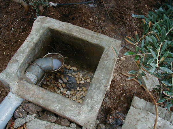 Figure 3.6: The manhole, together with a stainless steel sieve filter in al-Himmeh.
