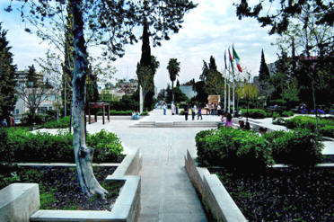 The central plaza of the National Gallery Park. The plaza includes a shallow water channel and grills opening to the park's underground water reservoir.