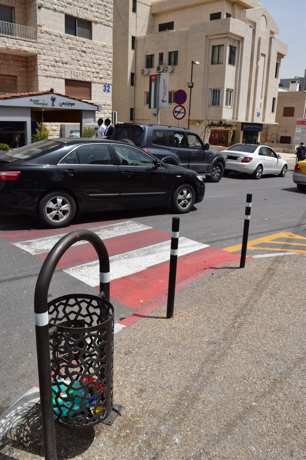 Low poles have been installed to prevent cars from parking on the sidewalk; and the street has been provided with new waste bins.