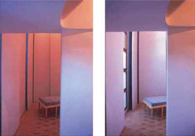 Work and consultation room: two views showing the different lighting effects that can be achieved by moving the sliding wall panels.