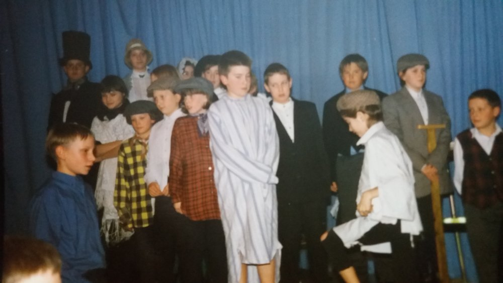Me (centre) in a nightshirt, as Ebeneezer Scrooge