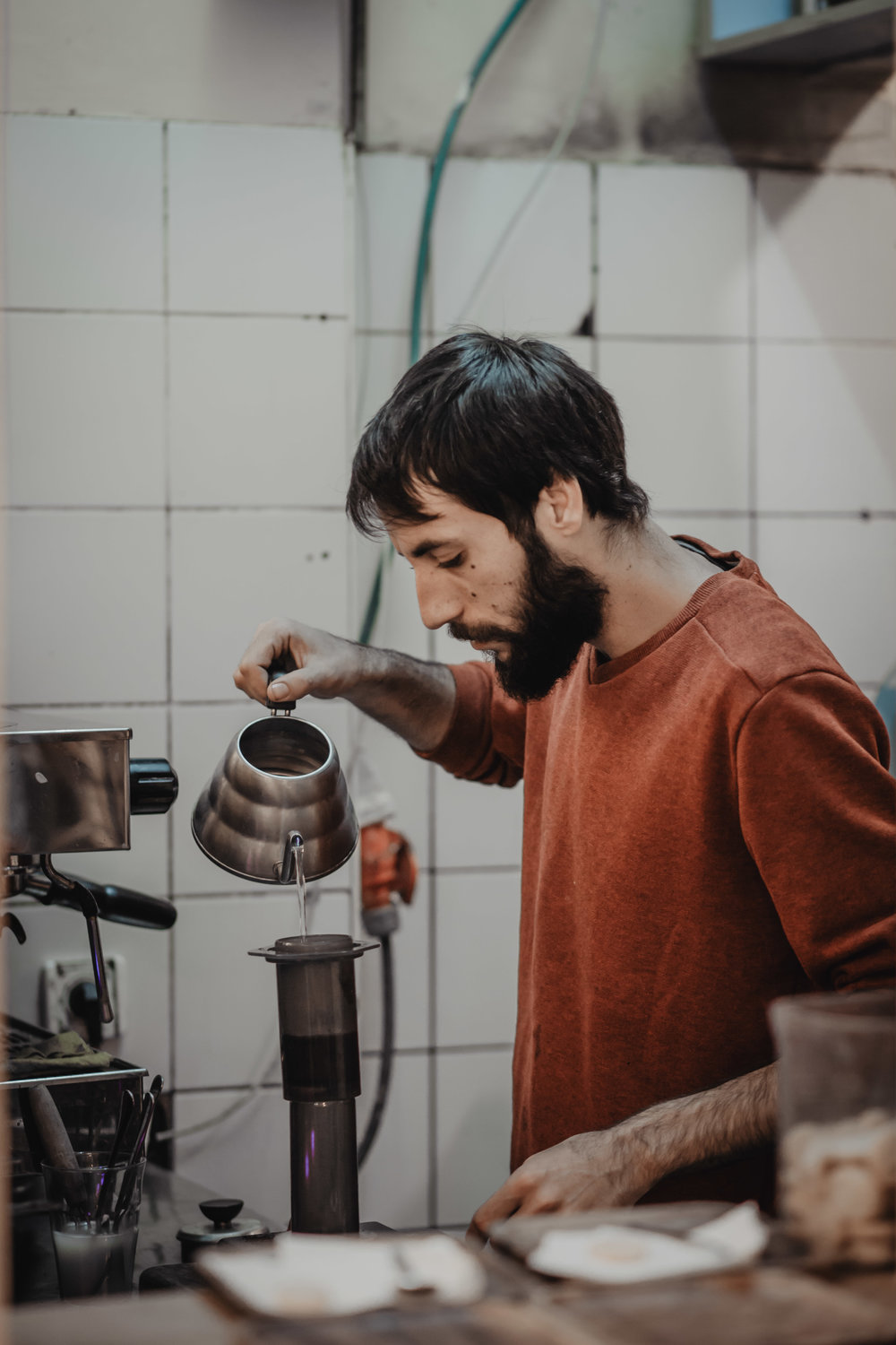Dotan preparing coffee using the Aeropress