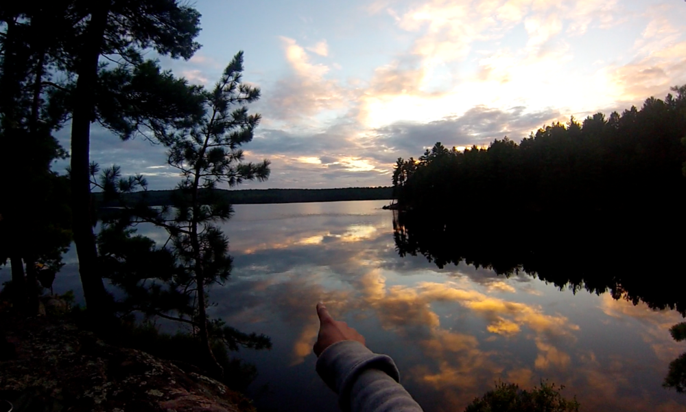 Algonquin - Tom Thompson Lake 2014 - pointing over the water at sunset.png