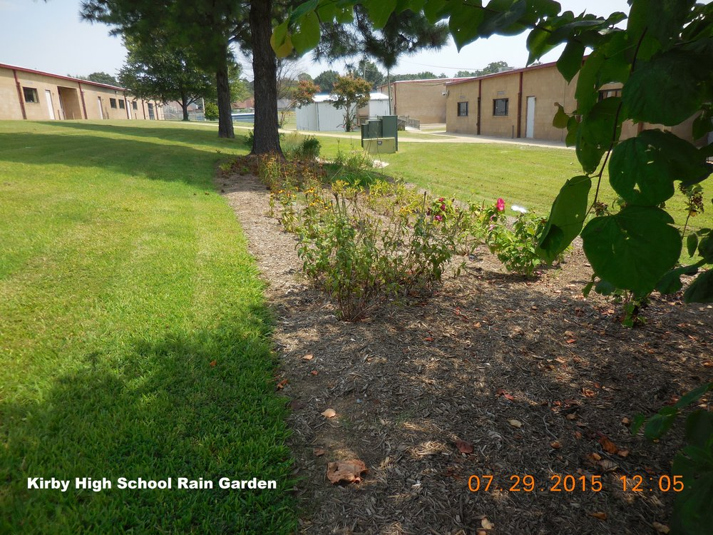 "One of the 3 original rain gardens after initial installation at Kirby High School. Since then, ""Project Rain Garden"" has evolved with the goal of installing 3 rain garden per year at schools who are interested in maintaining and utilizing the gardens to educate children and the community."
