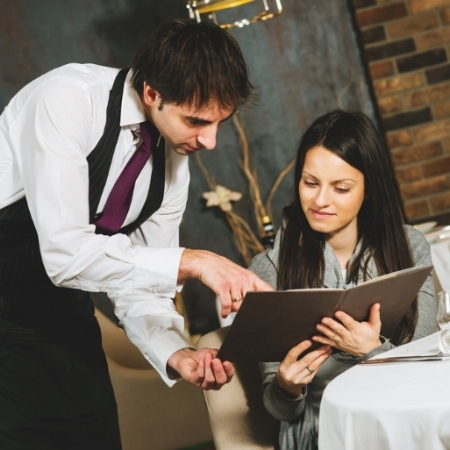 woman+ordering+wine+in+restaurant.jpg