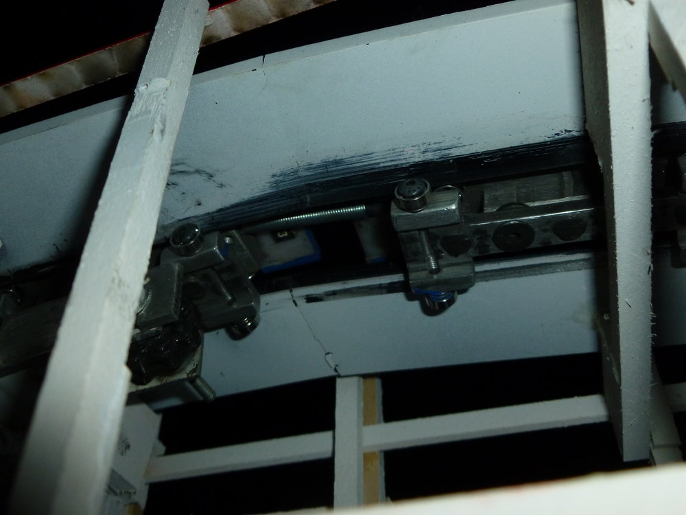 Close up of the train at the top of the lift. Note the large spring that is used as a car connector. You can also clearly see the up stop wheels and if you look carefully the side-friction wheels.