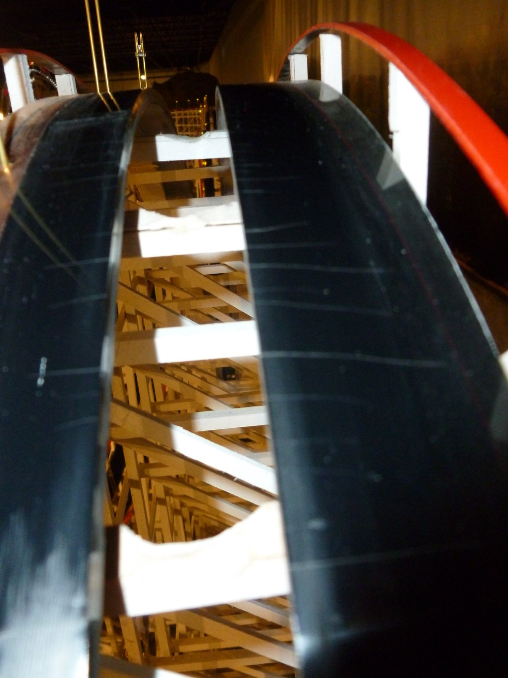 A view of the Lexan plastic track. It came colored black. They clean the track regularly with lubricant to keep it clean and dust free as much as possible. Also note the notches in the center of the crossties so the under carriage doesn't hit.