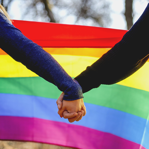 rainbow flag hands holding sq.jpg