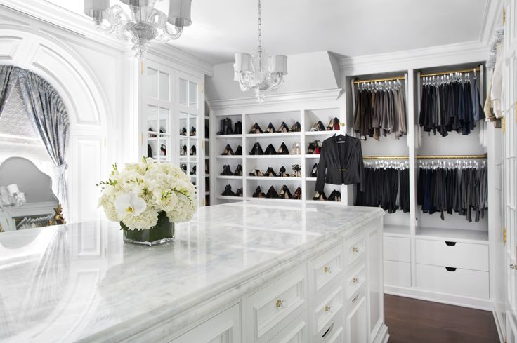 We'd be happy to have this be our kitchen or our closet! This marble island is definitely a gorgeous addition to the space and provides great storage!