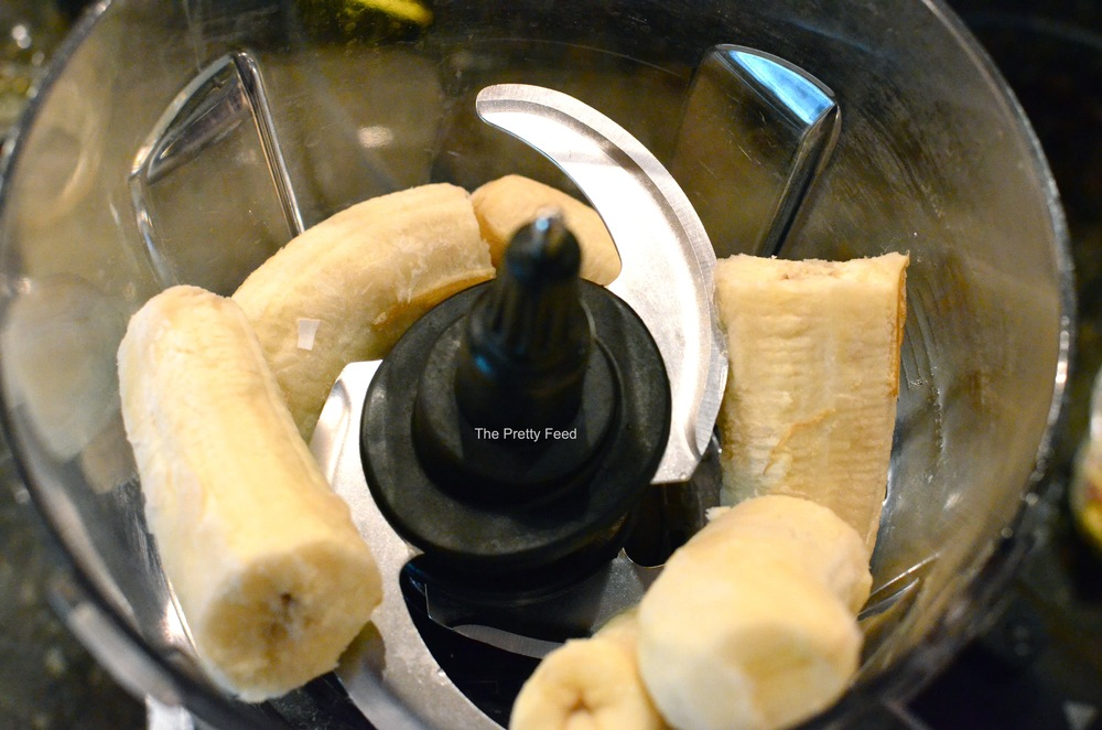 Place 3 frozen bananas (halved) into a strong blender.