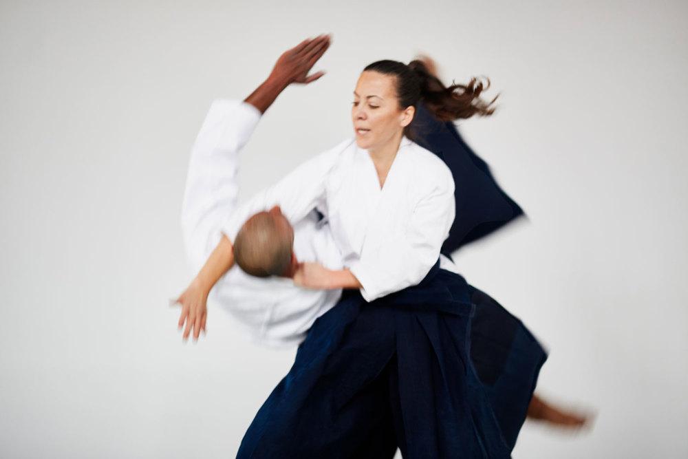 Instructor Maria Ferraro performs an aikido throw