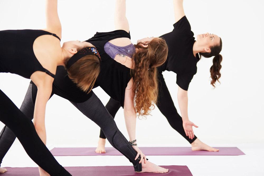 Instructor Maria Ferraro leads a yoga class