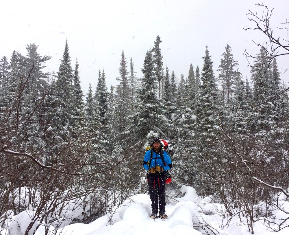 This was in the BWCAW of northern MN. We were backpacking to Eagle Mountain to camp and experienced a white out, wolves playing and the joys of truly deep snow. It was a magical trip.