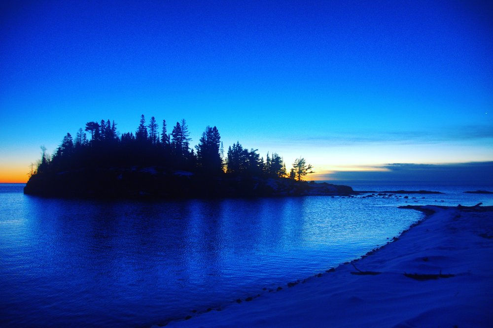 A winter camp. Very peaceful on Lake Superior. I do believe this was taken from right outside our tent. Sunrise is my favorite time of day.
