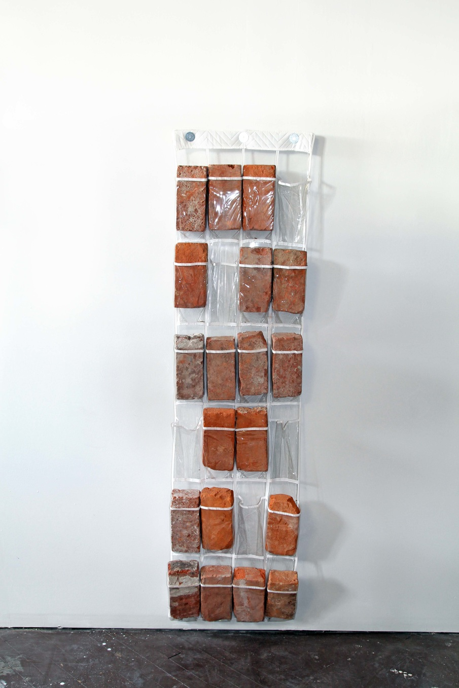 Kasey Toomey   Brick Rack , 2014/2017  Found Bricks, Plastic Shoe Rack, Wood  58x4x16 in.