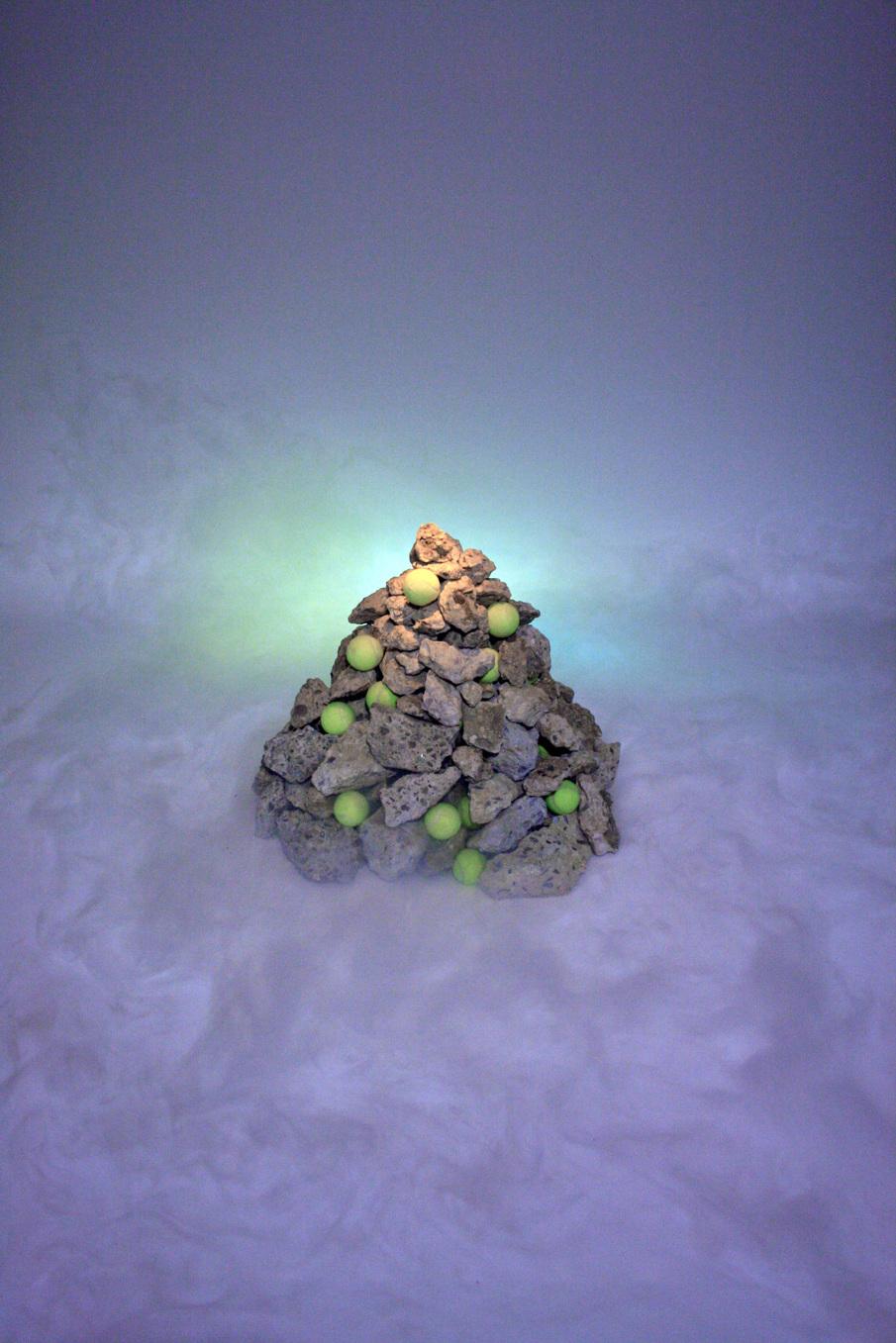 Kasey Toomey   Concrete Fog , 2014, 2017  Concrete Rubble, Tennis Balls, Fog