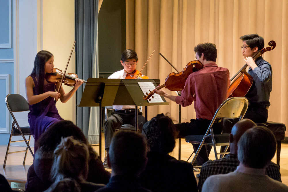 The Ann Newman Advanced Study String Quartet, coached by chamber music faculty member Sidney Curtiss, performs at a concert celebrating the 100th anniversary of the Mary Louise Curtis Brnach.