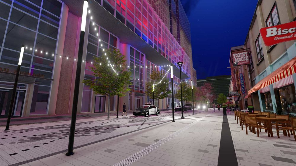 An overhead light canopy creates a human-scaled sense of enclosure and enlivens the nighttime streetscape.