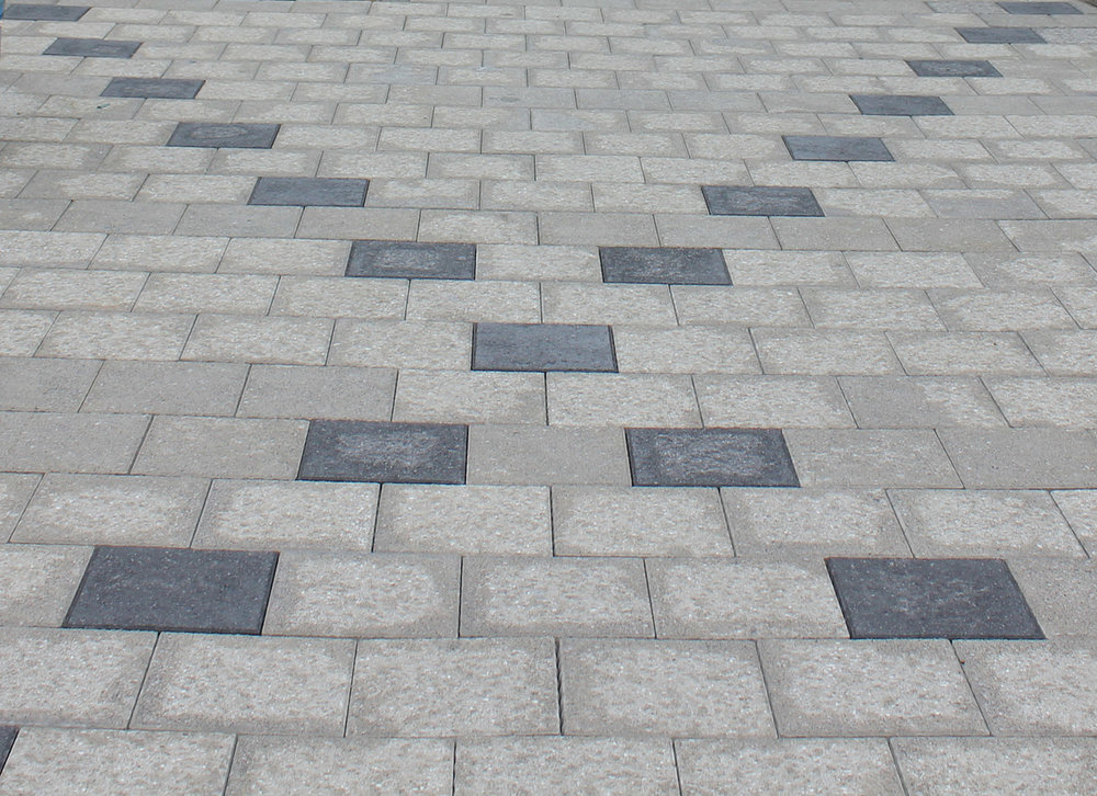 An abstract argyle pattern brings interest to the ground level.
