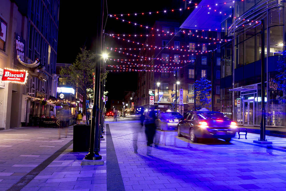An LED canopy brings additional vibrancy and energy to the street in the evening.
