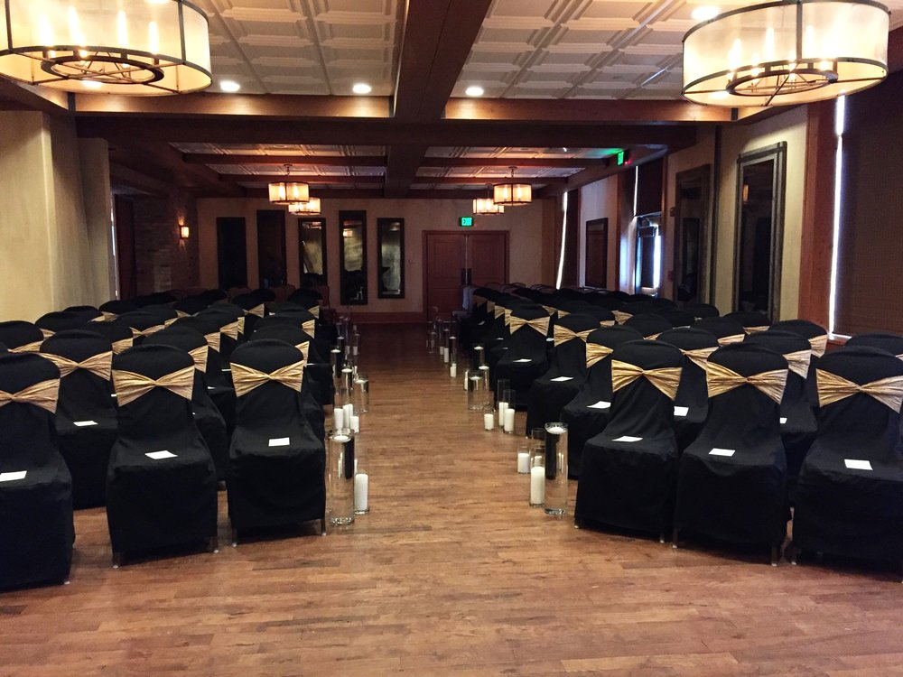 A banquet space set up for a ceremony at Ironworks Hotel