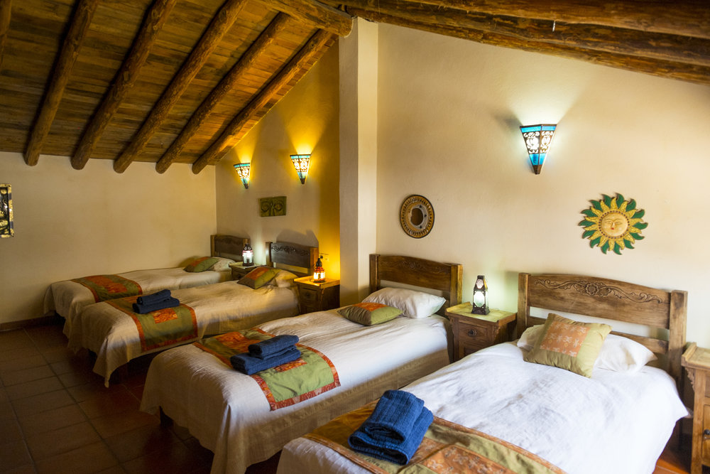 Govinda Mini-Dorm - $1550 Per person Spacious dorm rooms have 4 beds per room with shared bathrooms. They are beautifully appointed and comfortable.This four-person dorm is located upstairs in Casa Govinda and shares a bathroom with the twin room in Govinda.